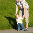 Baby first steps with father — Stock Photo #2263293