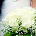 Bride holding her wedding bouquet — Stock Photo