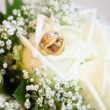 Royalty-Free Stock Photo: Wedding rings on the bouquet
