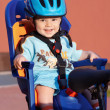 Happy baby in bicycle chair — Stock Photo
