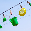 Child's toys on the clothesline - Stock Photo