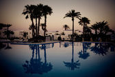 Swimming pool at evening — Stock Photo