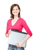 Smiling woman holding laptop — Stock Photo