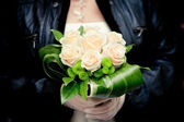 Bride holding her wedding bouquet — Stock Photo