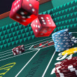 Casino craps, throwing dice — Stock Photo