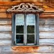 Stock Photo: Antique window in wooden wall