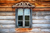Antique window in wooden wall — Stock Photo