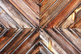 Wooden board tile and rusty nails heads — Stock Photo