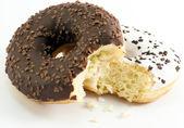Chocolate and vanilla donuts — Stock Photo