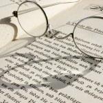 Eyeglass on book — Stock Photo #2390203
