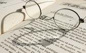 Eyeglass on book — Stock Photo