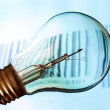 Bar code with old lightbulb — Stock Photo