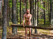 Man with log — Stock Photo