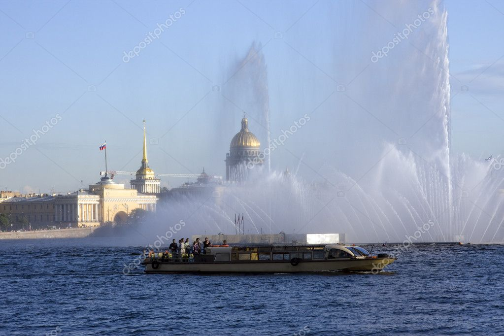 Pleasure motor ship in Neva river on floating fountain and architectural background, St. Petersburg.  Stock Photo #2506132