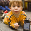 Small boy show picture on PPC — Stock Photo