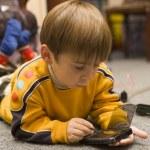 Small boy plays logic games on PPC — Stock Photo
