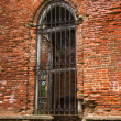 Ancient brick wall with window — Stock Photo