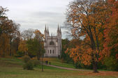 Gothic chapel in autumn park, Peterhof — Stock Photo