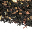 Black tea with dried fruit — Stock Photo