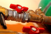 Heating equipment in boiler-room,red tap — Stock Photo