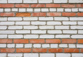 Old dirty white and red brick wall — Stock Photo