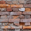 Old damaged brick wall — Stock Photo #2453626