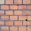 Old red brick wall and one yellow — Stock Photo #2453790