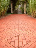 Red Brick Path to Fountain in Distance — Stock Photo