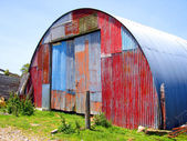 Round Metal Shed with Mismatched Paint — Stock Photo