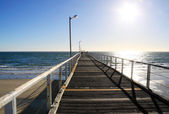 Long Wooden Jetty over Ocean — Stock Photo