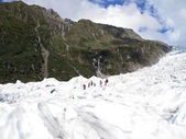 Tourists hiking on Fox Glacier, NZ — Stock Photo