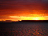 Deep red sunset over Lake Taupo, NZ — Stock Photo