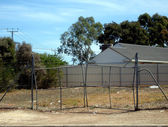Stretched Gates on Empty Lot — Stock Photo