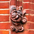 Ornate Decorations on Red Brick Wall - Foto Stock