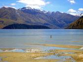 Man wading in Lake Wanaka, New Zealand — Stock Photo