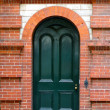 Stock Photo: Heritage Door in Decorative Brick Wall