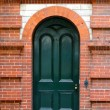 Heritage Door in Decorative Brick Wall — Stock Photo