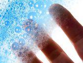 Fingers hold blue soap bubbles — Stock Photo