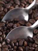 Coffee beans and spoons — Stock Photo
