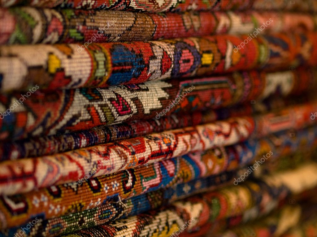 Closeup of a stack of colorful persian carpets with shallow depth of field — Stock Photo #2465652