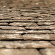 Old black tiles roof — Stock Photo