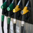 Green and yellow gas  pump rack - Stock Photo