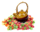Candied fruit and ceramic teapot — Stock Photo