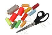 Scissors and threads — Stock Photo