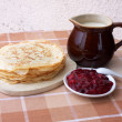 Foto Stock: Blini with milk and berry jelly