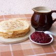 Stock Photo: Blini with milk and berry jelly