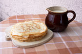 Blini with milk — Stock Photo