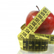 Foto Stock: Red apple with measuring tape
