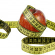 Red apple with measuring tape — Stock fotografie