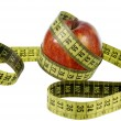 Red apple with measuring tape — Stock Photo #2372865